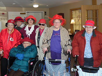 Residents from Immanuel Courtyard pose for a photo before going to Village Inn to eat pie.