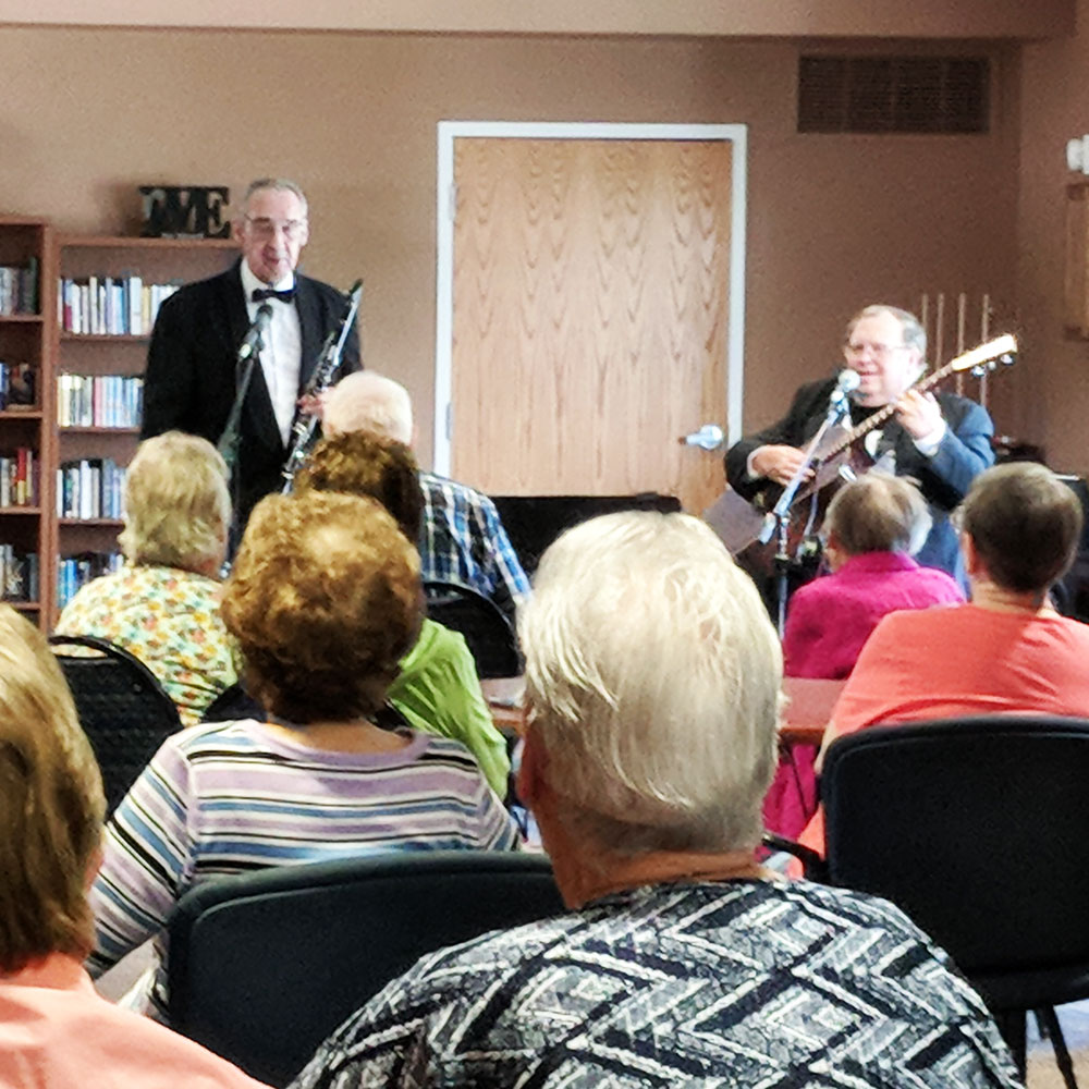 Residents enjoyed music by the group Snazzy at Trinity Courtyard retirement living community.