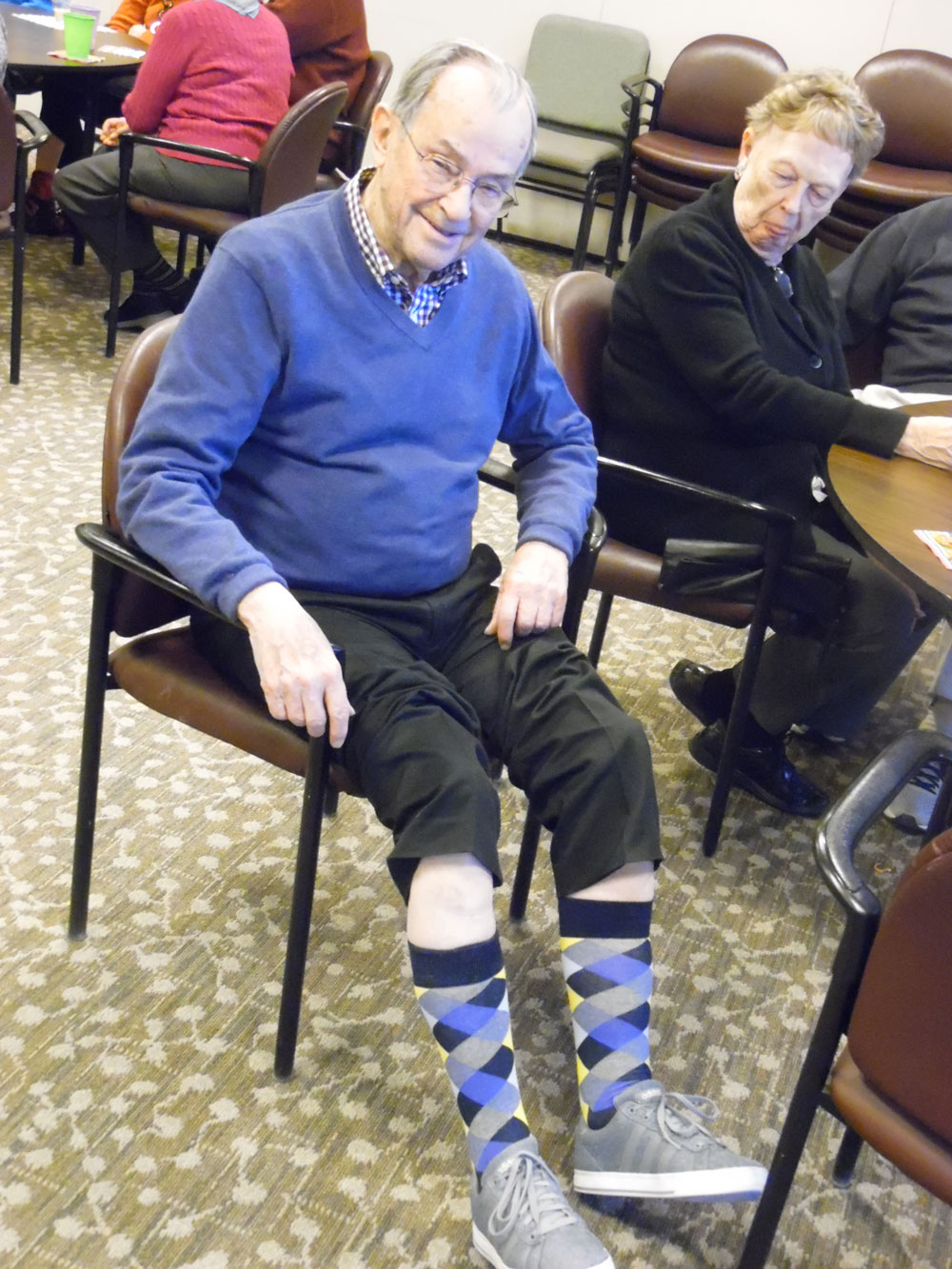 Pacific Springs Village residents show off their fashionable socks during a special Toasty Toes happy hour at the community