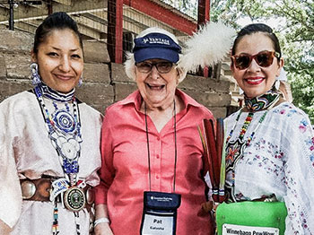 Pat Galusha, resident at The Arboretum, is photographed with female members of the Winnebago tribe.