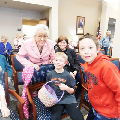 residents and young children pose with their easter baskets