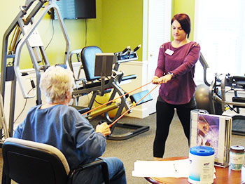 Residents at Pacific Springs Village receive one on one training with wellness staff.