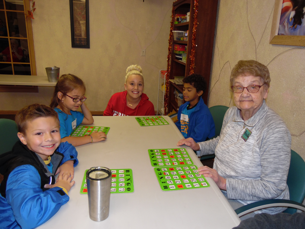 Residents from Immanuel Courtyard in Omaha, Nebraska participate in an activity with Lifegate Church and School students.