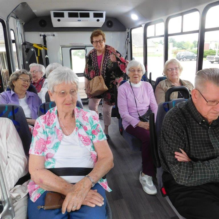 Residents enjoy the spacious interior of their new bus at Clark Jeary senior living community in Lincoln, Nebraska.