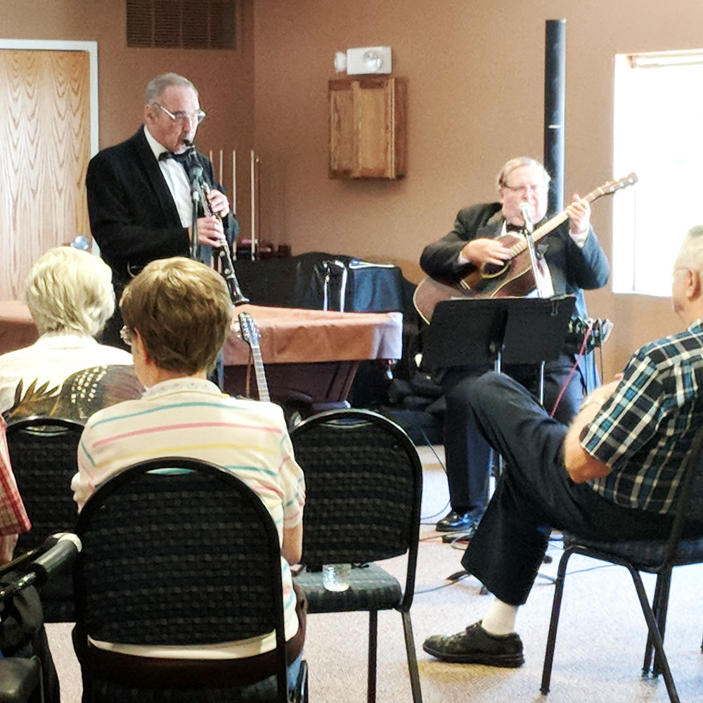Musicians visit Trinity Courtyard retirement living community to entertain residents.