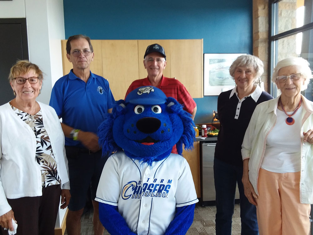 Residents from The Arboretum senior living community enjoy an outing to a Storm Chasers game in Omaha, Nebraska.