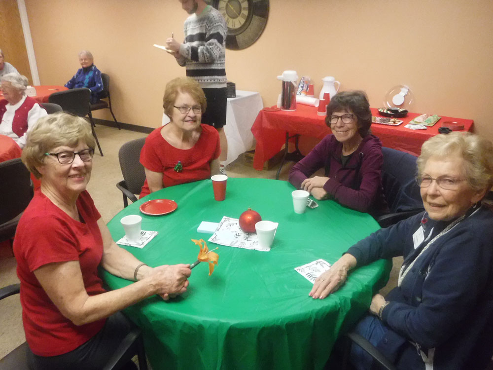 Residents and AgeWell members enjoy a Christmas party put together by Immanuel Village's Program