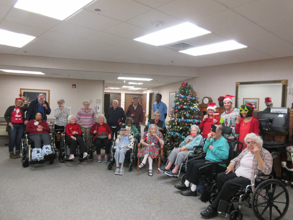 Residents from Immanuel Fontenelle pose for a photo during the annual Christmas party in which they received a Cheer Box
