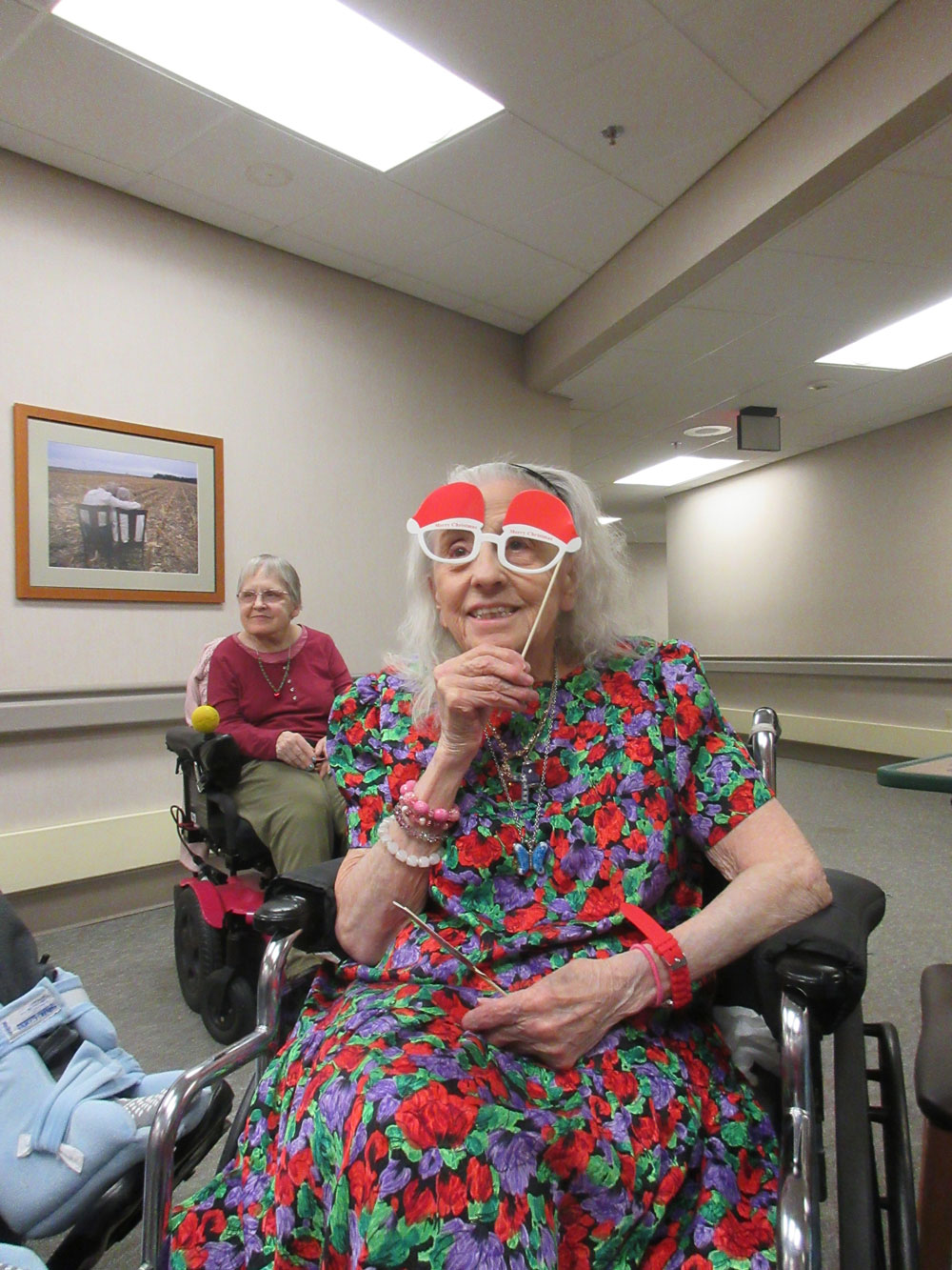 A resident from Immanuel Fontenelle senior living community poses for a photo during a Christmas party