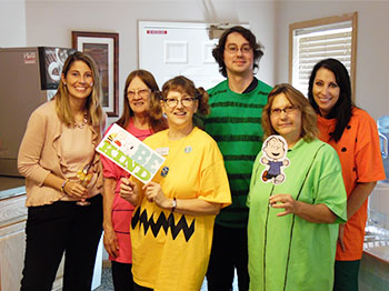 Staff members at Immanuel Courtyard celebrate with residents at a Charlie Brown social.