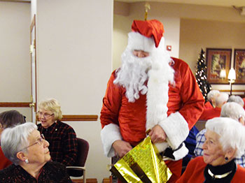 Santa visits with residents at a Christmas Party at The Landing senior living community
