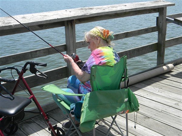 A participant from Immanuel Pathways in Southwest Iowa reels in a catch during a fishing excursion.