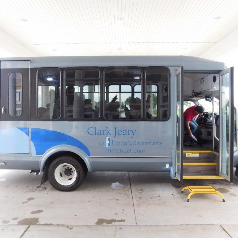 A new bus waits in the front entrance of Clark Jeary senior living community.