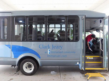 A brand new bus sits in the front entrance of Clark Jeary senior living community in Lincoln, Nebraska.